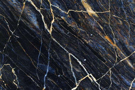 Yellow and white patterned natural of dark marble texture.