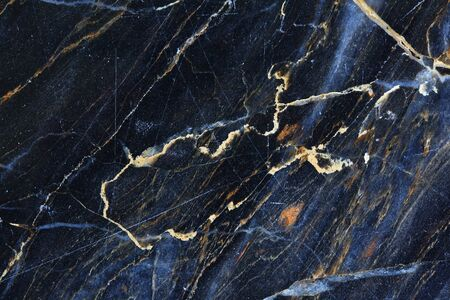 intrinsic: Gold, yellow and white patterned natural of dark gray marble texture.