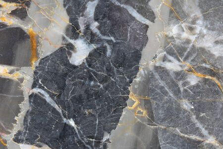 intrinsic: Gold yellow and white patterned natural of dark gray marble pattern texture for design product. Abstract marble background.