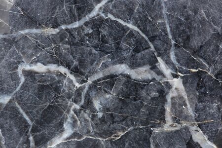 intrinsic: dark gray marble pattern texture, abstract background.