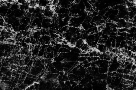 White patterned natural with black and white marble texture, abstract dark background.