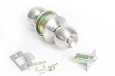 Stainless steel round ball door knob components isolated on white background as Locksmith concept.