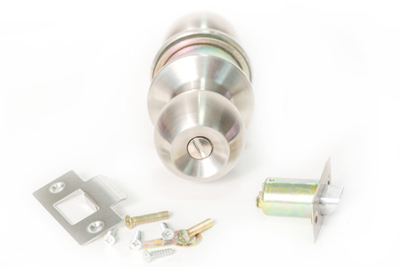 Stainless steel round ball door knob components isolated on the white background as Locksmith concept. Stock Photo