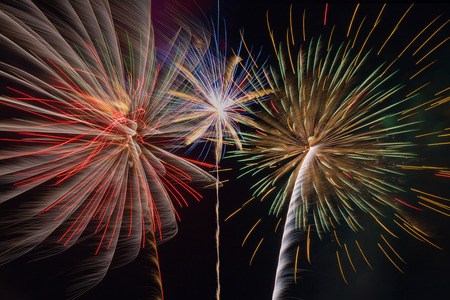 Colorful fireworks of various colors over sky at night background.