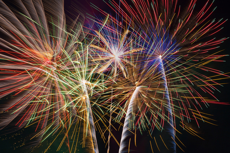 Colorful fireworks of various colors background. Stock Photo