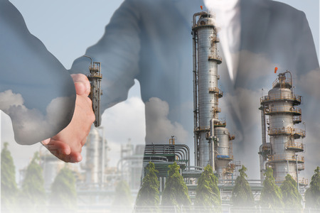 Double exposure of handshake and Electric Generating Factory as teamwork and energy concept.