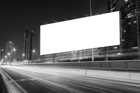 street signs: black and white tone of blank billboard on light trails, street and urban in the night - can advertisement for display or montage product or business.