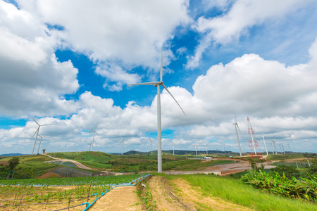 refinement: Huge wind turbine under clouds and blue sky, beautiful nature and Renewable power background Stock Photo