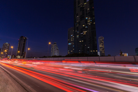 The light trails on the street and urban at dusk as city life background. Reklamní fotografie