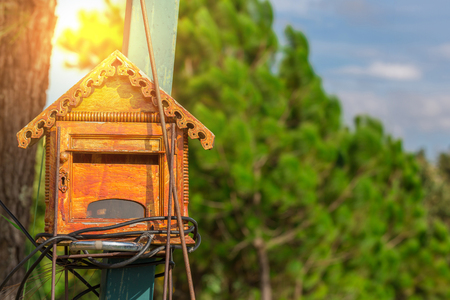 postage: post or mail box and sunlight of sunrise in the morning Stock Photo