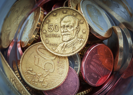 Closeup of Euro coins in bottle and shadow as business, money, banking, currency and exchange rate concept Stok Fotoğraf - 72211712