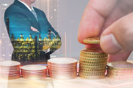 double exposure of Euro Coin stacks on table and electric generating factory, industry as business, investment,currency, exchange rate and energy concept