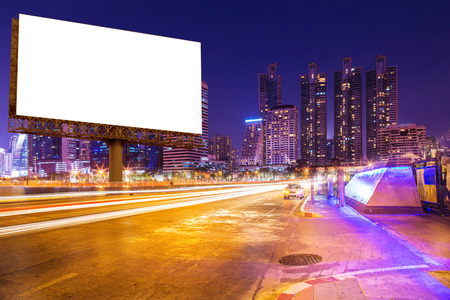 blank billboard on light trails, street and urban in the night - can advertisement for display or montage product or business Stock Photo