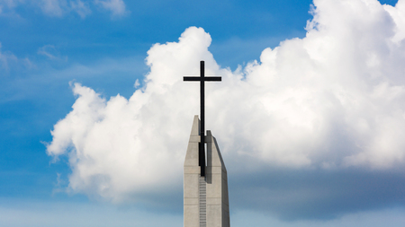 center of cross on a church on blue sky and clouds background Stock Photo