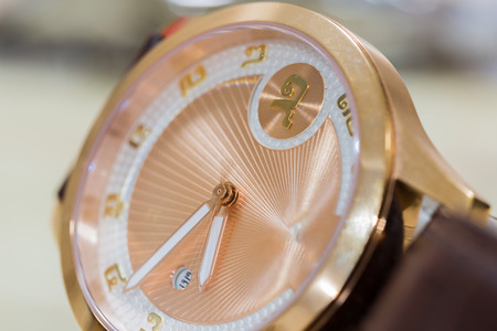 Close-up Luxury golden hand watch. Best accessories background.