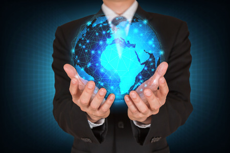 Businessman holding the glowing polygonal hologram digital globe as business, innovation, intelligent, idea and globalization concept.