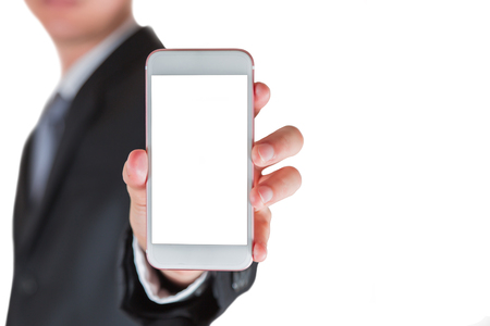 Businessman hold and show blank screen of smartphone display isolated on white for input free space as advertising concept.