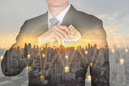 double exposure of Businessman put Euro money in his suit pocket and 4G 5G node networking cellsite and cityscape at sunset as business, investment, financial flexibility and saving concept. Standard-Bild