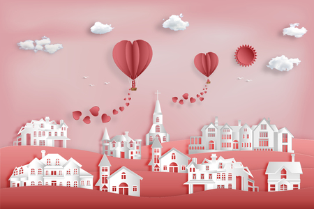 Paper art , cut and craft style design of pink village with the Lover in hot air balloon in sky as valentine, romantic and lovely concept. vector illustration.
