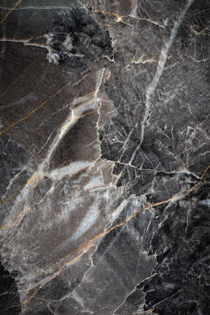 White and yellow patterned natural detailed of dark gray marble (Russia Gold) texture background for interior or product design
