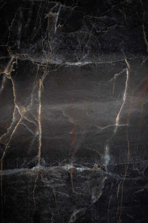 White and yellow patterned natural detailed of dark gray marble (Russia Gold) texture background