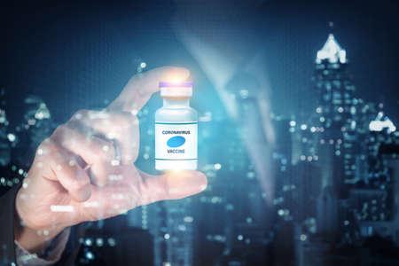 coronavirus vaccine or covid-19 vaccine inside the hand of the businessman as business idea concept.