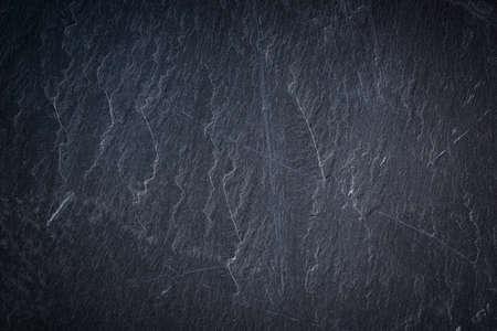 Dark gray slate texture, abstract background Фото со стока