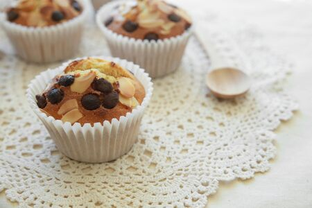 chocolate chip: Homemade apricot chocolate chip almond slice muffins with spoon