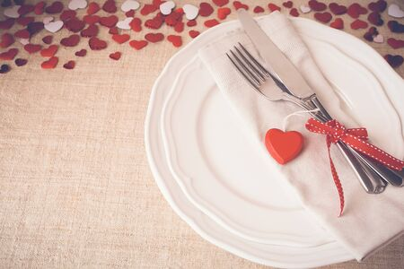 flower designs: Valentine table setting copy space background, selective focus, vintage tone Stock Photo