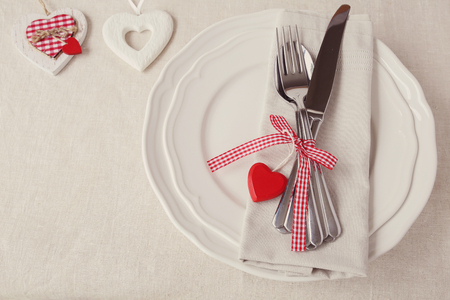romantic dinner: Valentine table setting copy space background, selective focus, vintage tone Stock Photo