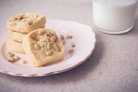 pine nut: Homemade ginger and pine nut cookies, selective focus, toning