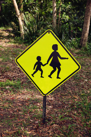 drivers: Rustic Yellow children crossing sign, vintage filter Stock Photo