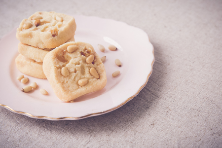 gingerbread cookie: Homemade ginger and pine nut cookies, selective focus, toning