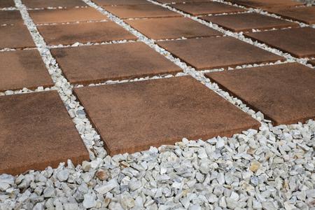 patio: Paving Pebble Patio in rows, selective focus Stock Photo