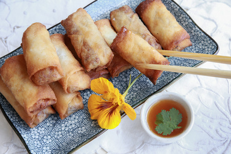 edible: Homemade spring rolls garnished with edible flower