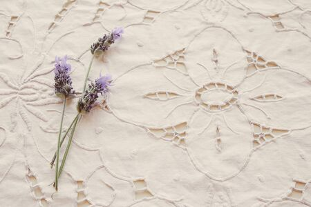 White floral linen embroidery fabric background with lavender flowers, vintage filter Archivio Fotografico