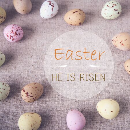 he: Easter eggs with Easter, He is risen word, toning Stock Photo