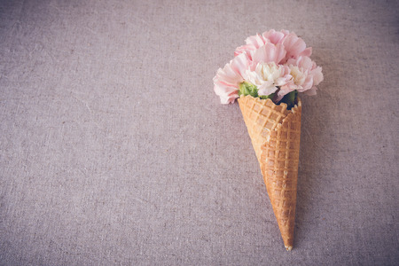 selective focus: Pink carnation flowers in ice cream waffle cone,selective focus