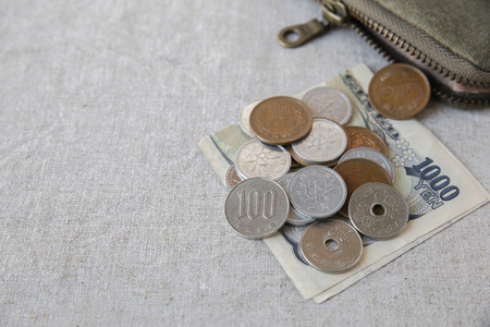 pouch: Japanese money, Yens wtih small money pouch Stock Photo