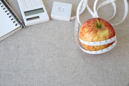 weightloss: Apple, tape measure, notebook and calculator background for diet plan, weightloss plan Stock Photo