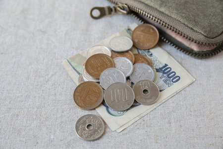 monte carlo: Japanese money, Yens wtih small money pouch Stock Photo