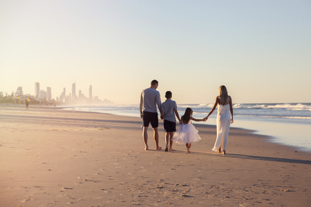 Family of four portrait on the beach, soft selective focus, toning Stock Photo