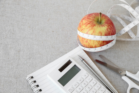 weightloss plan: Apple, tape measure, notebook and calculator background for diet plan, weightloss plan Stock Photo