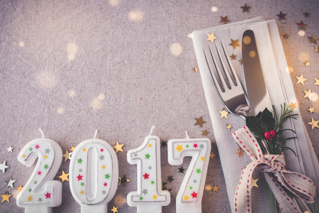 dining set: Happy New Year 2017 table place setting, holidays copy space fairy light toning background