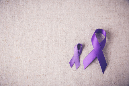 Purple ribbons toning copy space background, Alzheimer's disease, Pancreatic cancer, Epilepsy awareness, Hodgkin's Lymphoma awareness 版權商用圖片