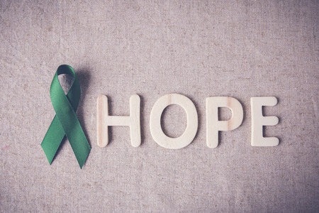 Green Ribbon with HOPE wooden word, cancer awareness, Liver, kidney cancer awareness