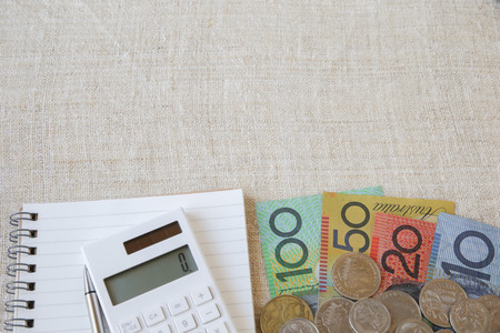 australian money: Australian money, AUD with calculator, notebook and small money pouch, copy space background