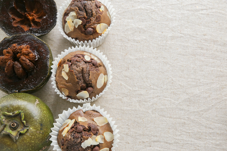 Homemade cupcakes made from Black sapote chocolate pudding fruit, copy space background