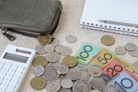australian money: Australian money, AUD with calculator, notebook and small money pouch