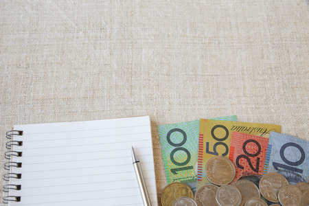 australian money: Australian money, AUD with notebook and small money pouch, copy space background